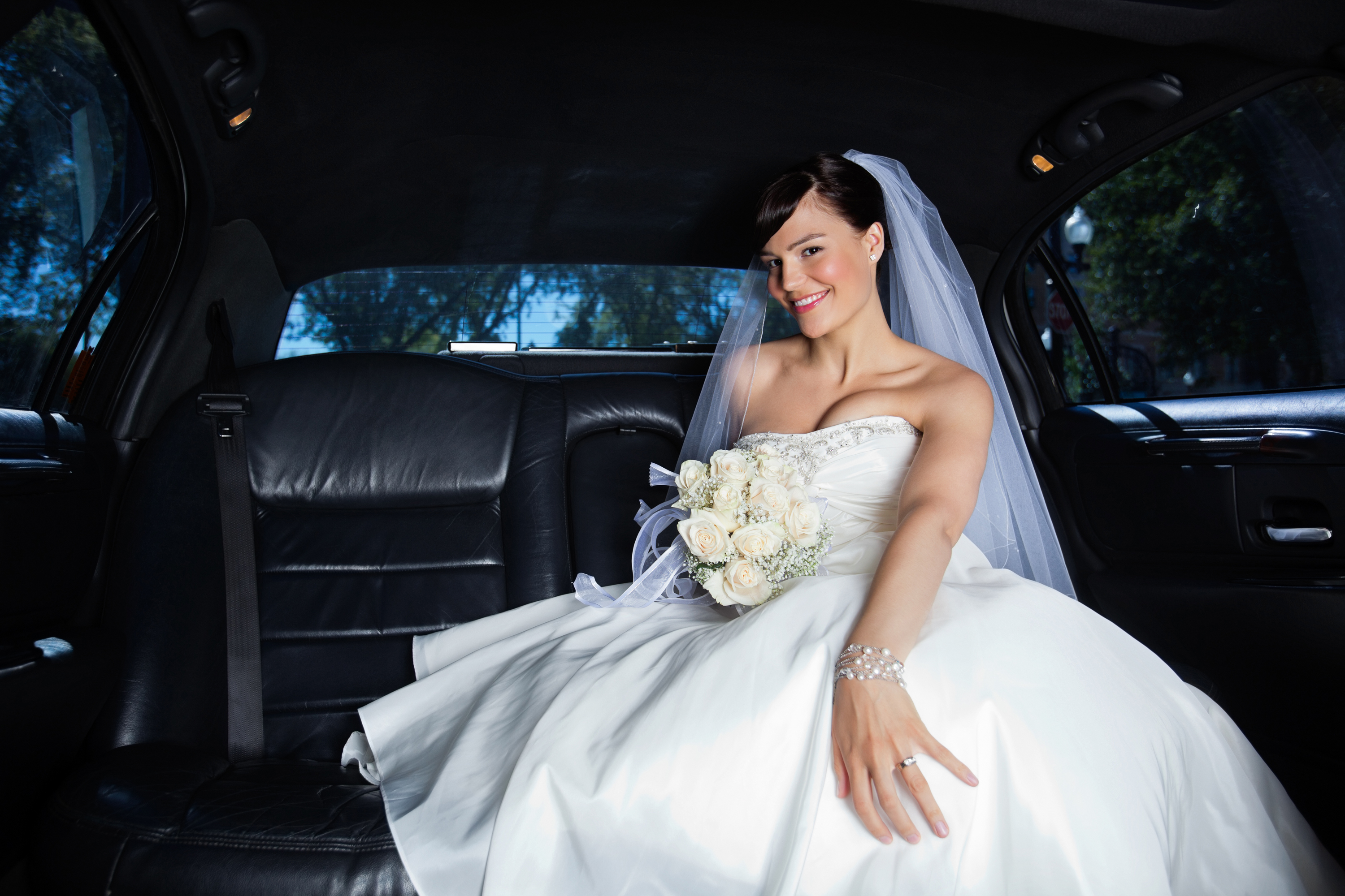 bigstock-Beautiful-bride-sitting-in-car-29877425